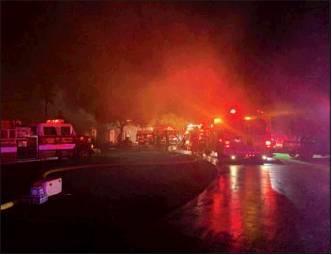Several VFDs battle large house ablaze