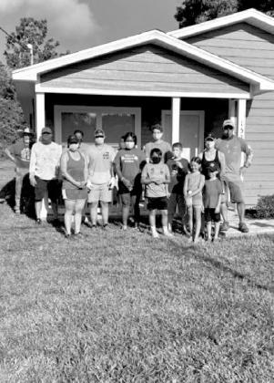 4-H works on Habitat for Humanity home landscaping