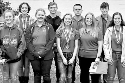 Sacred Heart swim teams medal at State