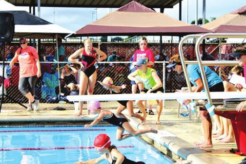 CATfish Swim team paddles past Sharks