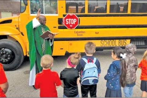Bus blessing for St. Anthony School