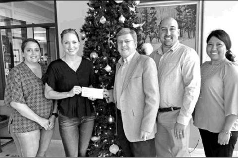 Industry State Bank donates to local ministry